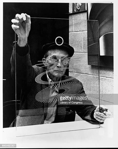 Marcel Duchamp Holding a Glass Study for The Large Glass: The Bride Stripped Bare by Her Bachelors, Even