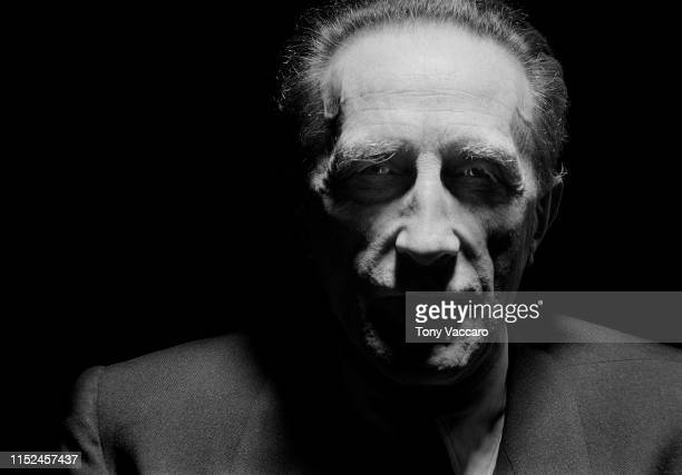 Marcel Duchamp the artist is standing under a street lamp at 4 am in the morning and his face is in shadow but you do see his eyes.