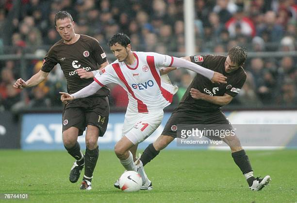 Marcel Eger and Marvin Braun of St.Pauli and Dino Toppmoeller of Offenbach fight for the ball during the Second Bundesliga match between FC St.Pauli...