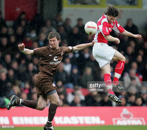 Marcel Eger of StPauli and Andreas Glockner of SC Freiburg compete for the ball during the Second Bundesliga match between FC StPauli and SC Freiburg...