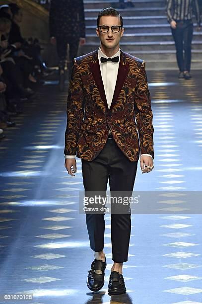 Marcel Floruss walks the runway at the Dolce Gabbana Autumn Winter 2017 fashion show during Milan Menswear Fashion Week on January 14 2017 in Milan...