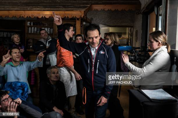 TOPSHOT Marcel Fourcade father of France's biathlon athlete Martin Fourcade works and reacts as he watches on television his son Martin Fourcade...