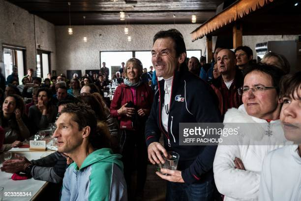 Marcel Fourcade father of France's biathlon athlete Martin Fourcade works and reacts as he watches on television his son Martin Fourcade competing in...