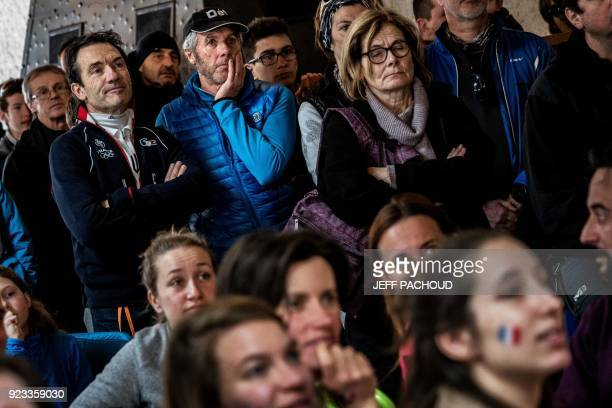 Marcel Fourcade father of France's biathlon athlete Martin Fourcade works and watches on television his son Martin Fourcade competing in the men's...