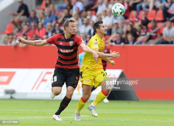 Marcel Gaus of FC Ingolstadt 04 and Steven Skrzybski of 1 FC Union Berlin during the Trikotvorstellung on July 29 2017 in Berlin Germany
