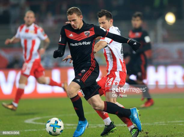 Moritz Hartmann of FC Ingolstadt 04 and Steven Skrzybski of 1 FC Union Berlin during the game between Union Berlin and dem FC Ingolstadt 04 on...