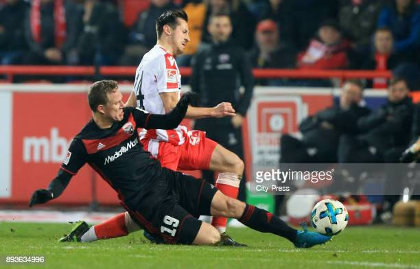 Marcel Gaus of FC Ingolstadt 04 and Steven Skrzybski of 1 FC Union Berlin during the game between Union Berlin and dem FC Ingolstadt 04 on december...