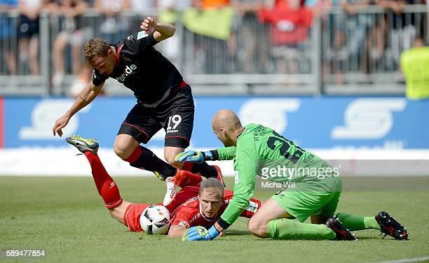 Marcel Gaus of Kaiserslautern Clemens Schoppenhauer of Wuerzburg and Daniel Halfar of Kaiserslautern tussle for the ball during the Second Bundesliga...