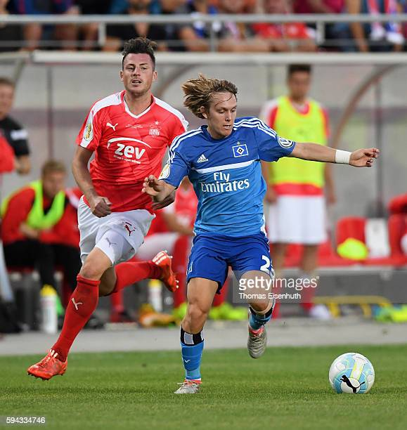 Marcel Gebers of Zwickau is challenged by Alen Halilovic of Hamburg during the DFB Cup match between FSV Zwickau and Hamburger SV at Stadion Zwickau...