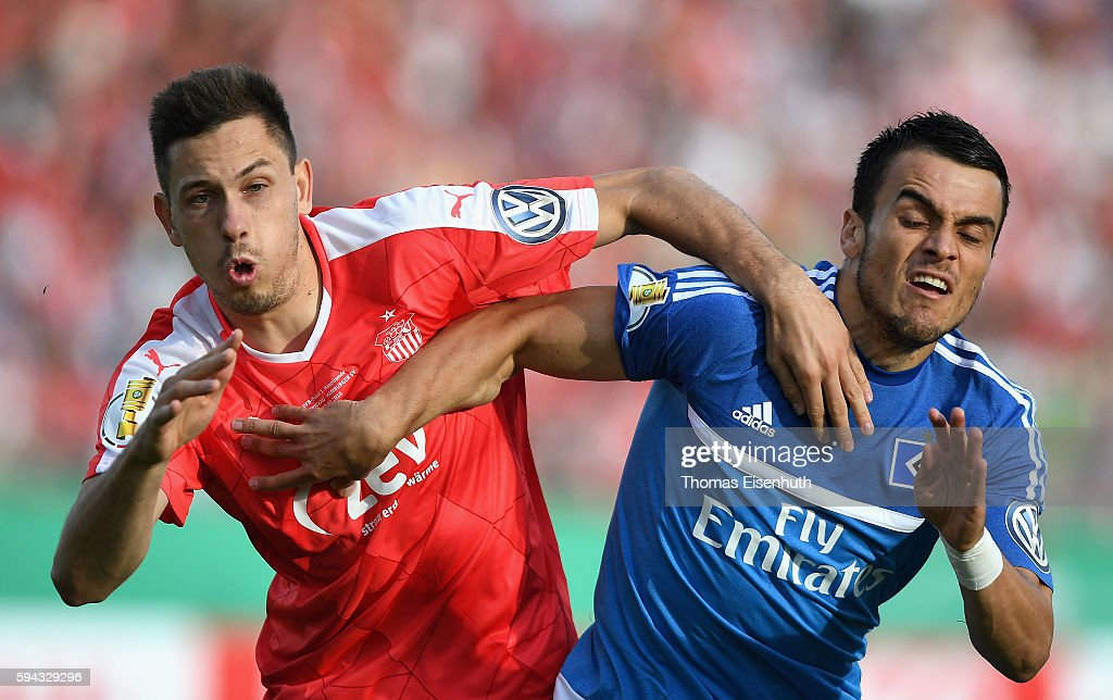 Marcel Gebers (L) of Zwickau is challenged by Filip Kostic of Hamburg during the DFB Cup match between FSV Zwickau and Hamburger SV at Stadion Zwickau on August 22, 2016 in Zwickau, Germany.