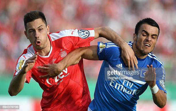 Marcel Gebers of Zwickau is challenged by Filip Kostic of Hamburg during the DFB Cup match between FSV Zwickau and Hamburger SV at Stadion Zwickau on...