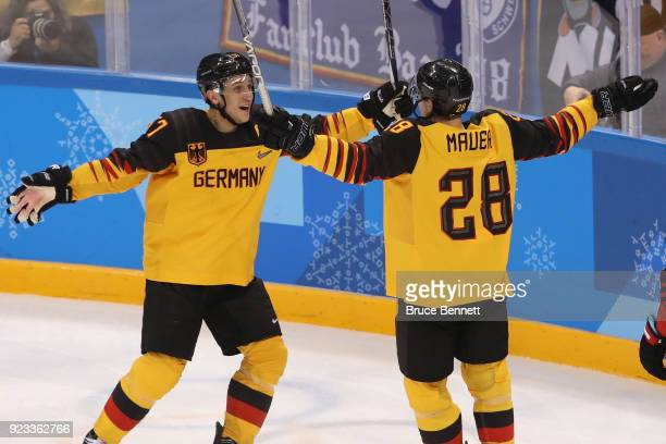 Marcel Goc and Frank Mauer of Germany celebrate after a goal by Mauer in the second period during the Men's Playoffs Semifinals on day fourteen of...