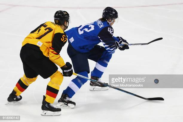 Marcel Goc of Germany battles for the puck with Miro Heiskanen of Finland during the Men's Ice Hockey Preliminary Round Group C game on day six of...