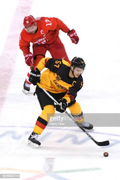 Marcel Goc of Germany controls the puck against Pavel Datsyuk of Olympic Athlete from Russia in the third period during the Men's Gold Medal Game on...