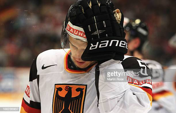 Marcel Goc of Germany looks dejected after losing the IIHF World Championship semifinal match between Russia and Germany at Lanxess Arena on May 22...