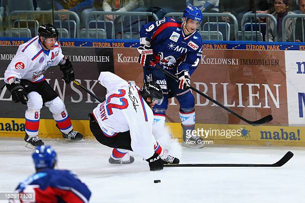 Marcel Goc of Mannheim is challenged by Yan Stastny and Jame Pollock of Ice Tigers during the DEL match between Adler Mannheim and Thomas Sabo Ice...