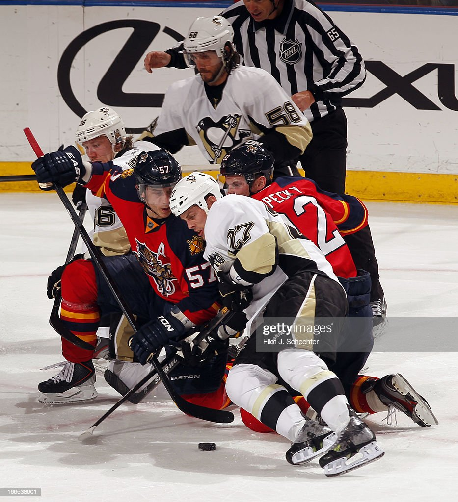 Marcel Goc #57 of the Florida Panthers crosses sticks with Craig Adams #27 of the Pittsburgh Penguins at the BB&T Center on April 13, 2013 in Sunrise, Florida.