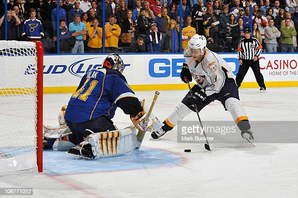 Marcel Goc of the Nashville Predators shoots against Jaroslav Halak of the St Louis Blues to win the game 32 in shootouts in an NHL game on November...