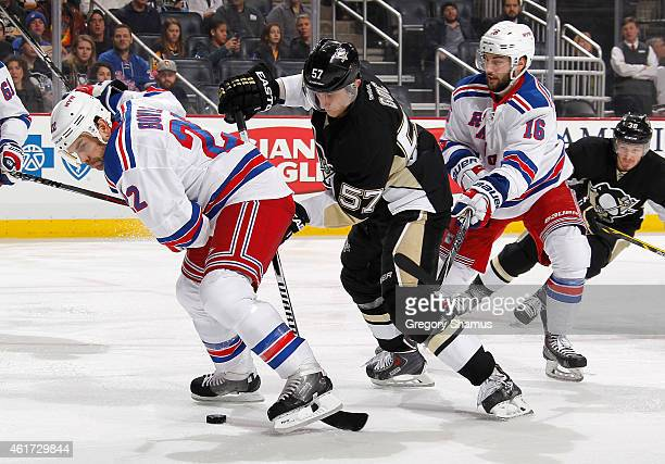 Marcel Goc of the Pittsburgh Penguins battles for the puck against Dan Boyle and Derick Brassard of the New York Rangers at Consol Energy Center on...