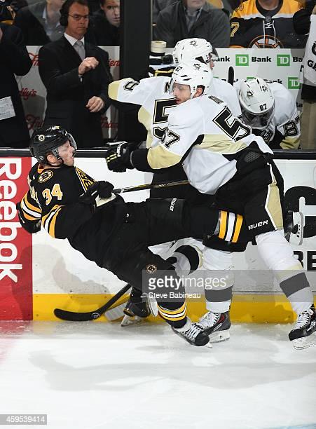 Marcel Goc of the Pittsburgh Penguins checks Carl Soderberg of the Boston Bruins at the TD Garden on November 24 2014 in Boston Massachusetts