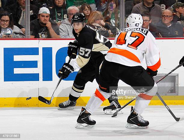 Marcel Goc of the Pittsburgh Penguins makes a pas in front of the defense of Andrew MacDonald of the Philadelphia Flyers on March 16 2014 at Consol...