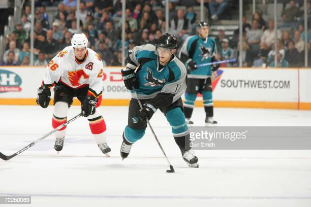 Marcel Goc of the San Jose Sharks skates with the puck during a preseason game against the Calgary Flames on September 30 2006 at the HP Pavilion in...