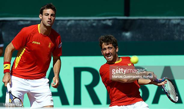 Marcel Granollers and Marc Lopez of Spain in action againist Bob Bryan and Mike Bryan of United States during day two of the semi final Davis Cup...