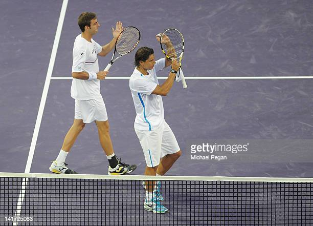 Marcel Granollers and Rafael Nadal of Spain celebrate winning their doubles match against Marin Cilic and Ivo Karlovic of Croatia during day 4 of the...
