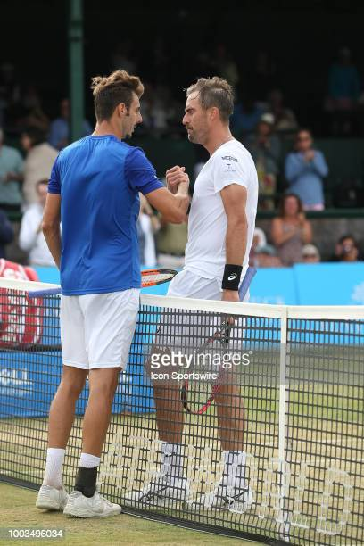 Marcel Granollers congratulates Steve Johnson after their semifinal match of the Dell Technologies Hall of Fame Open at the International Tennis Hall...