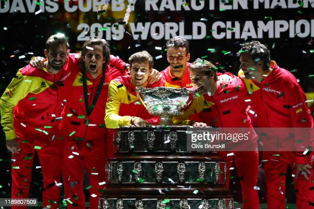 Marcel Granollers Feliciano Lopez Pablo Carreno Busta Roberto Bautista Agut Rafael Nadal and team captain Sergi Bruguera celebrate with the trophy...