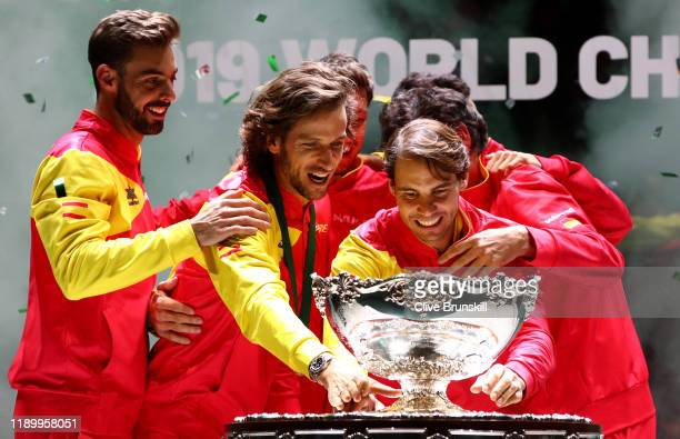 Marcel Granollers Feliciano Lopez Pablo Carreno Busta Roberto Bautista Agut and Rafael Nadal celebrate with the trophy following their victory over...
