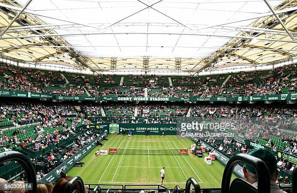 Marcel Granollers of Spain against Philipp Kohlschreiber of Germany under closed roof during the ATP Tournament in Halle, Germany, on June 15, 2016....