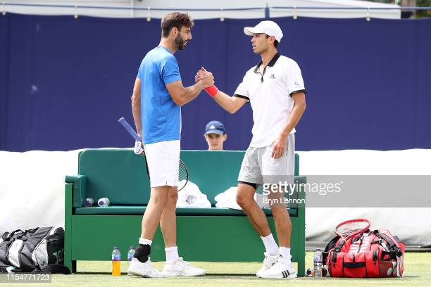 Marcel Granollers of Spain and Ben McLachlan of Japan celebrate winning the Men's Doubles Final during the Women's Single Final at Surbiton Racquet...