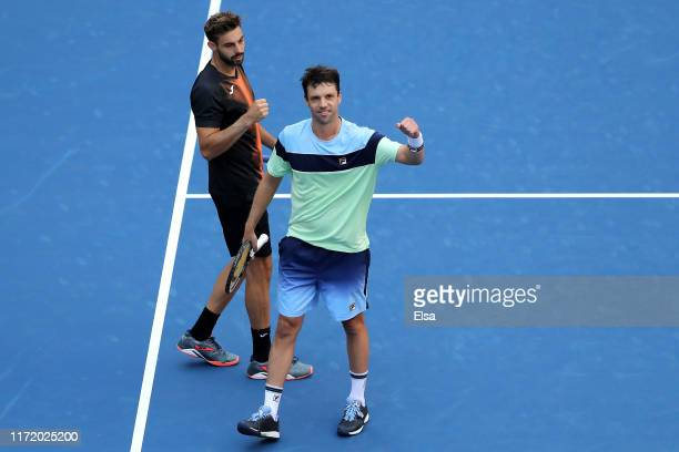 Marcel Granollers of Spain and Horacio Zeballos of Argentina celebrate after winning their Men's Doubles quarterfinal match against Oliver Marach and...