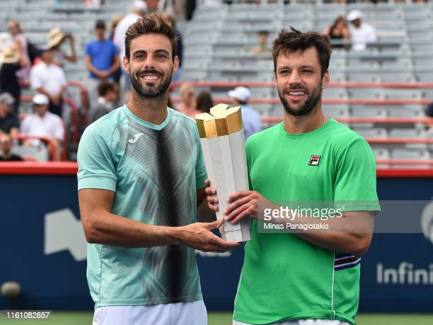 Marcel Granollers of Spain and Horacio Zeballos of Argentina hold up the championship trophy after defeating Robin Haase and Wesley Koolhof of the...