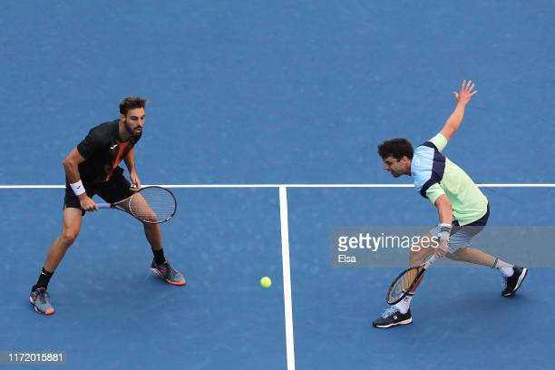 Marcel Granollers of Spain and Horacio Zeballos of Argentina in action during their Men's Doubles quarterfinal match against Oliver Marach and Jurgen...