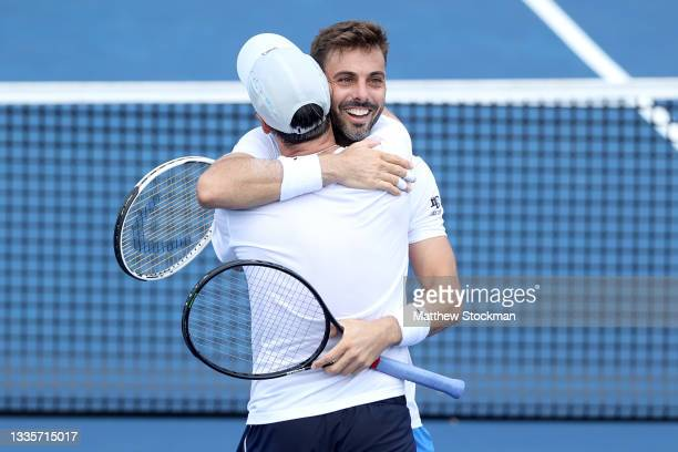 Marcel Granollers of Spain and Horacio Zeballos of Argentina celebrate match point against Steve John Johnson and Austin Krajicek during the doubles...