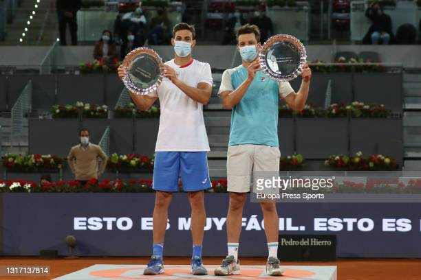 Marcel Granollers of Spain and Horacio Zeballos of Argentina pose for photo with the trophy after winning their Men's Doubles Final match against...