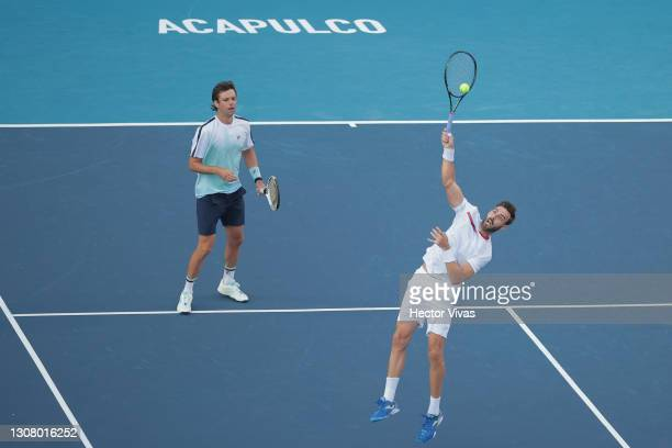 Marcel Granollers of Spain and Horacio Zeballos of Argentina return the ball during the Doubles Semifinal match between Marcel Granollers of Spain...