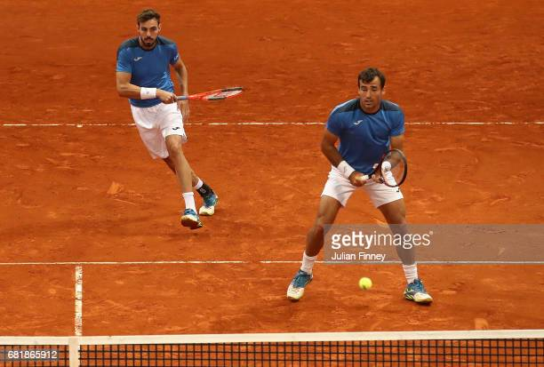 Marcel Granollers of Spain and Ivan Dodig of Croatia in action in their doubles match against Fabio Fognini of Italy and Treat Huey of Philippinnes...