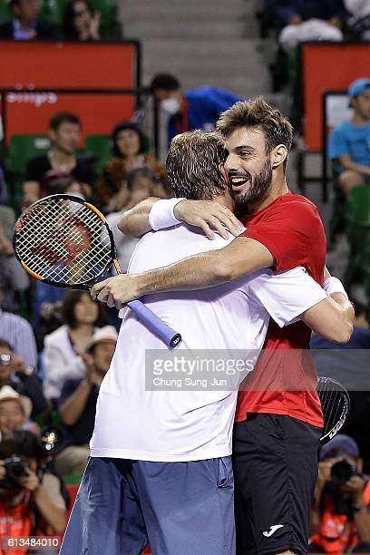 Marcel Granollers of Spain and Marcin Matkowski of Poland celebrate after winning the men's doubles final match against Raven Klaasen of South Africa...