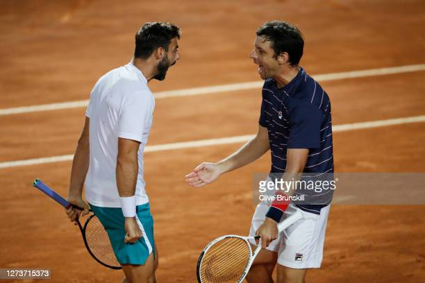 Marcel Granollers of Spain and playing partner Horacio Zeballos of Argentina celebrate match point in their men's doubles final against Jeremy Chardy...