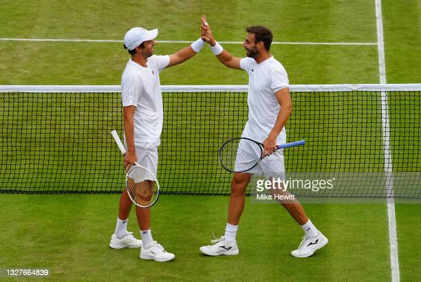 Marcel Granollers of Spain and playing partner Horacio Zeballos of Argentina celebrate victory after winning their Men's Doubles Semi-Final match...
