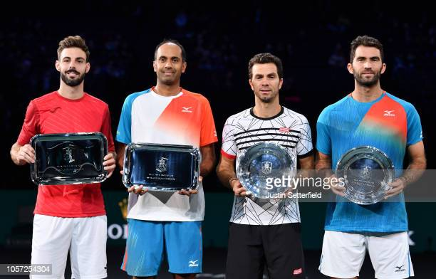 Marcel Granollers of Spain and Rajeev Ram of The United States of America pose with runners up Horia Tecau of Romania and JeanJulien Rojer of The...