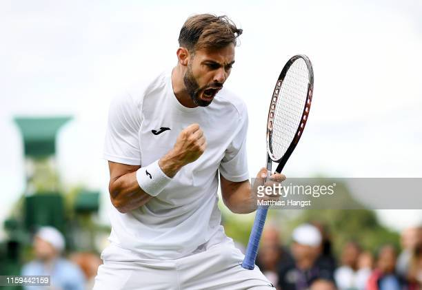 Marcel Granollers of Spain celebrates during a first set tiebreak in his Men's Singles first round match against Lorenzo Sonego of Italy during Day...