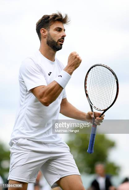Marcel Granollers of Spain celebrates in his Men's Singles first round match against Lorenzo Sonego of Italy during Day one of The Championships...