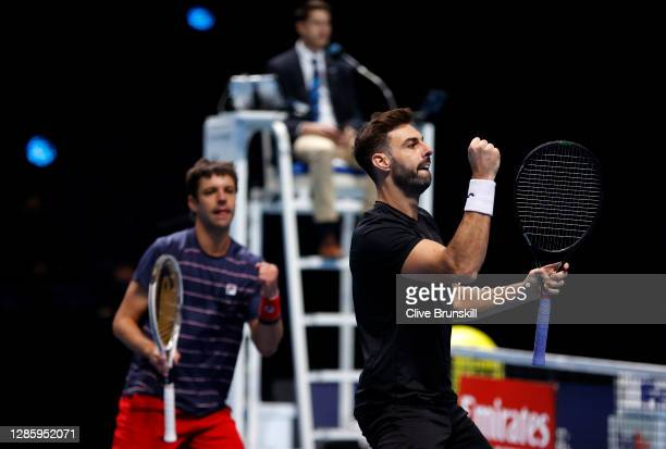 Marcel Granollers of Spain celebrates with partner Horacio Zeballos of Argentina during their doubles match against John Peers of Australia and...