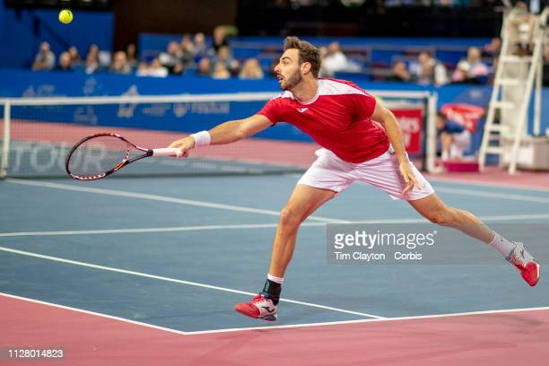Marcel Granollers of Spain in action against Denis Shapovalov of Canada during the Open Sud de France Tennis Tournament at the Sud de France Arena on...