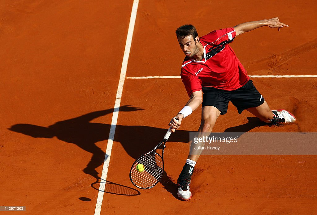 Marcel Granollers of Spain in action against Julien Benneteau of France during day two of the ATP Monte Carlo Masters on April 16, 2012 in Monte-Carlo, Monaco.