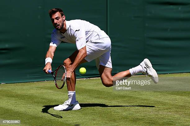 Marcel Granollers of Spain in action in his Mens Doubles match with Marc Lopez against Mateusz Kowalczyk and Igor Zelenay during day two of the...